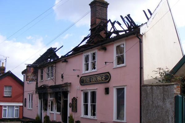 The George pub. The pink building is missing its roof.