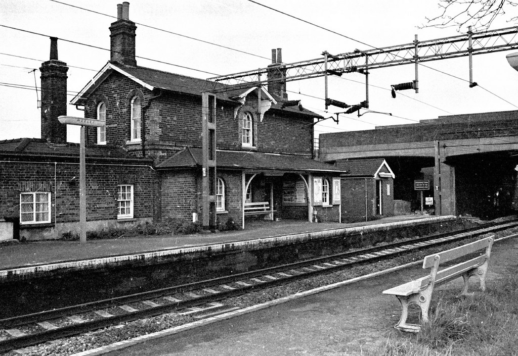 A black and white historic photograph of the station building.